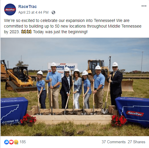 RaceTrac employees outside digging into the dirt with shovels