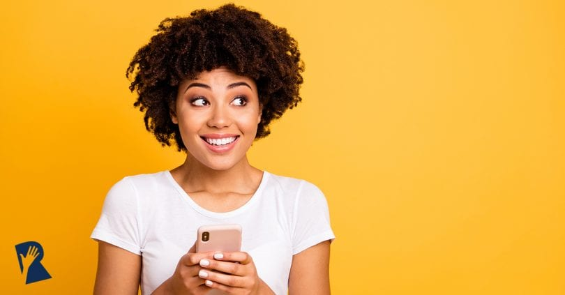 Woman on her phone smiling