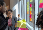 Employees writing sticky notes