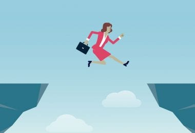 Business woman leaping to success