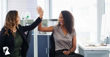 Women celebrating their marketing wins