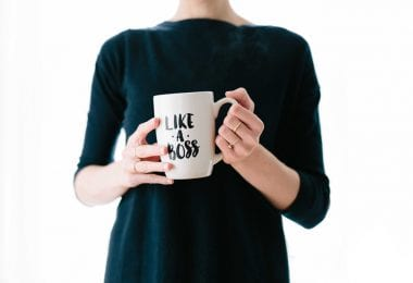 Woman holding like a boss mug