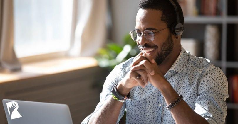 Man conducting a virtual job interview on a laptop